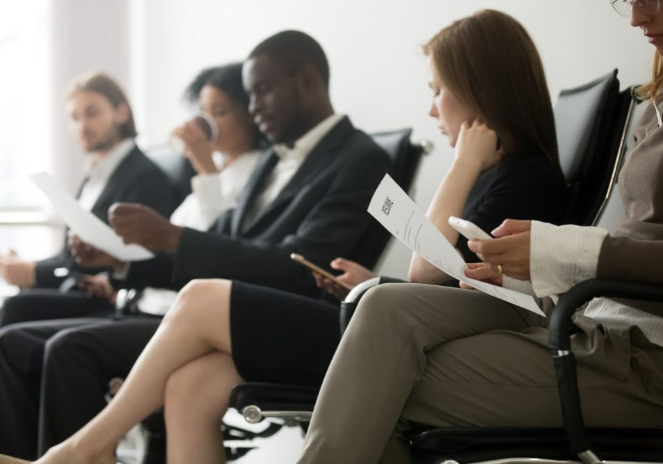 Multi-ethnic,Applicants,Sitting,In,Queue,Preparing,For,Interview,,Black,And